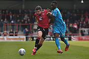 Morecambe Defender, Aaron McGowan (2) and Barnet Forward, Simeon Akinola (14) during the EFL Sky Bet League 2 match between Morecambe and Barnet at the Globe Arena, Morecambe, England on 28 April 2018. Picture by Mark Pollitt.