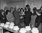 Cake Decoration Awards At Drogheda..1973..02.04.1973..04.03.1973..2nd April 1973..At Drogheda Technical School an award ceremony took place for achievement in cake decoration..Mc'Donnells Foods were the sponsors of the event..Image shows the overall winner in the Advanced section of the Cake Decorating Competition, John Smith, 22 Patrick Street,Drogheda,accepting his award. The award was presented by Mr Brendan Flanagan, Sales Manager,Mc'Donnells Foods. included in the picture are some of the other entrants in the competition.