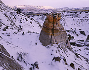AA00876-01...NORTH DAKOTA - Sunset over a snow-covered Theodore Roosevelt National Park.