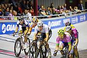 Nikki Terpstra (midden) en Jasper de Buyst (rechts) in gevecht tijdens een koppelkoers. In Amsterdam vindt de Zesdaagse van Amsterdam plaats, een groots wielerevenement in het velodrome.<br /> <br /> Nikki Terpstra (center) and Jasper de Buyst in a duet at the Six Days of Amsterdam, a major cycling event in the velodrome.
