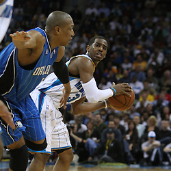 18 February 2009: New Orleans Hornets guard Chris Paul (3) looks to pass as Orlando Magic center Tony Battie (4) defends during a 117-85 win by the New Orleans Hornets over the Orlando Magic at the New Orleans Arena in New Orleans, Louisiana.