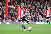 Brentford striker, Lasse Vibe (21) with a shot on goal during the Sky Bet Championship match between Brentford and Bristol City at Griffin Park, London, England on 16 April 2016. Photo by Matthew Redman.