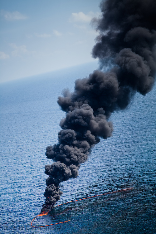 6-10-2010 Skimmer boats near the source of the BP oil spill in  Gulf Of Mexico gather oil and conduct a controlled burn.