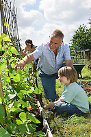 Family with boy gardening