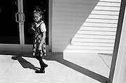 GLASGOW, KY – SEPTEMBER, 2009: A young girl walks into the front door of South Fork Baptist Church.