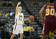February 18, 2010: Iowa guard Jaime Printy (24) signals to her teammates during the second half of the NCAA women's basketball game at Carver-Hawkeye Arena in Iowa City, Iowa on February 18, 2010. Iowa defeated Minnesota 75-54.