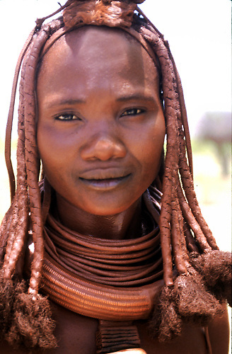 Namibia. OvaHimba woman portrait.  Muddy dreadlocks with copper necklaces. Nomadic tribes-woman..©Patrick King/iAfrika Photos