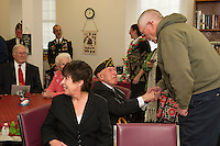Pvt 1st Class Cadorette receives purple heart and bronze stars from WWI with Senator Kelly Ayotte at the Belmont Mill.  Karen Bobotas for the Laconia Daily Sun