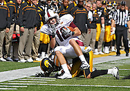 September 24, 2011: Louisiana Monroe Warhawks wide receiver Brent Leonard (18) is hit by Iowa Hawkeyes cornerback Micah Hyde (18) during the second quarter of the game between the Iowa Hawkeyes and the Louisiana Monroe Warhawks at Kinnick Stadium in Iowa City, Iowa on Saturday, September 24, 2011. Iowa defeated Louisiana Monroe 45-17.