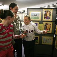 Flagmount Pupils Michelle O'Connor,Jessie O'Donnell and Orla Broderick  at the Art Exhibition opening at Flagmount National School on Friday night.<br /> <br /> Photograph by Eamon Ward