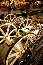 California, San Francisco: Cable Car transportation. Large wheels turn cables at Cable Car Barn. Photo 5-casanf77903. Photo copyright Lee Foster.