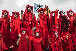 © Licensed to London News Pictures. 16/04/2019. London, UK. A group of performance artists join Extinction Rebellion protesters on Waterloo Bridge as police begin to arrest demonstrators. The protesters are demanding urgent action from governments on climate change. Photo credit: Rob Pinney/LNP