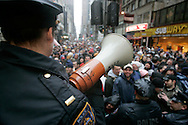 Police officers watch over the audience at a rally to celebrate the final broadcast on FM radio of Howard Stern in New Yorkspeaks to the crowd durring a rally 16 December 2005.After 21 years on the air and millions of dollars of fines from the FCC, Stern signed a $500 million 5-year deal with the largely unregulated  Sirius satellite radio which begins broadcasts