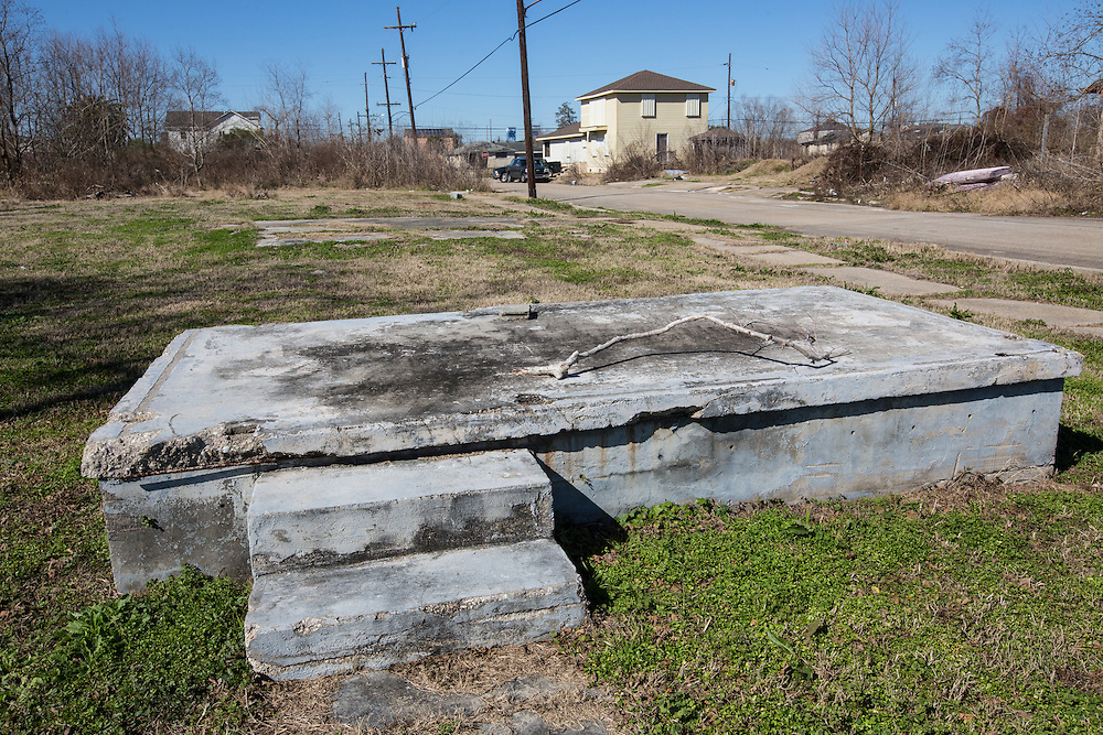 New Orleans, LA, January 20, Foundation of a home left in the path of a broken levee in from of a new home across from the  Industrial Canal in New Orleans lower 9th Ward.Nine years after hurricane Katrina parts of the city have still not recovered.
