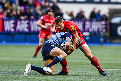 Cardiff Blues' Tom James is tackled by Scarlets' Scott Williams - Mandatory by-line: Craig Thomas/Replay images - 31/12/2017 - RUGBY - Cardiff Arms Park - Cardiff , Wales - Blues v Scarlets - Guinness Pro 14