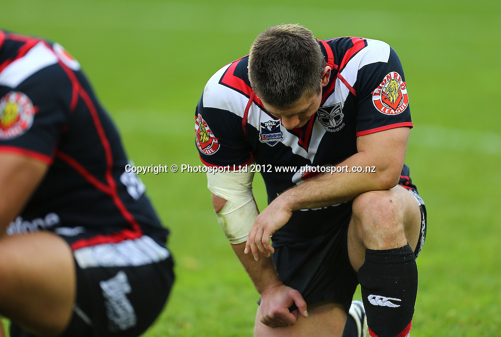 Jacob Lillyman of the Warriors kneels dejectedly after the loss during the NRL game, Vodafone Warriors v Penrith Panthers, Mt Smart Stadium, Auckland, Sunday 19 August  2012. Photo: Simon Watts /photosport.co.nz
