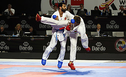 November 10, 2018 - Madrid, Madrid, Spain - Anton Isakau seen fighting with the Turkish Ugur Aktas to compete for the Bronze Medal during the Kumite male -84kg competition of the 24th Karate World Championships at the WiZink centre in Madrid. (Credit Image: © Manu Reino/SOPA Images via ZUMA Wire)