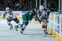 KELOWNA, CANADA - JANUARY 22: Austin Adam #29 of the Everett Silvertips checks Tyson Baillie #24 of the Kelowna Rockets into the boards during the second period on January 22, 2014 at Prospera Place in Kelowna, British Columbia, Canada.   (Photo by Marissa Baecker/Getty Images)  *** Local Caption *** Austin Adam; Tyson Baillie;