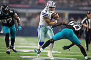 ARLINGTON, TX - OCTOBER 14:  Dak Prescott #4 of the Dallas Cowboys fumbles the football, then picks it up and runs before breaking the tackle of Telvin Smith Sr. #50 of the Jacksonville Jaguars at AT&T Stadium on October 14, 2018 in Arlington, Texas.  The Cowboys defeated the Jaguars 40-7.  (Photo by Wesley Hitt/Getty Images) *** Local Caption *** Dak Prescott; Telvin Smith