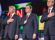 Presidential hopeful Donald Trump (left), Ted Cruz and Jeb Bush during the national anthem before the CNN Republican Presidential Debate at the Venetian Hotel and Casino in Las Vegas.