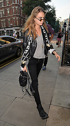 Model Cara Delevingne out and about during London Fashion Week SS15. London, UK. 16/09/2014<br />BYLINE MUST READ : GOTCHAIMAGES.COM<br /><br />Copyright by © Gotcha Images Ltd. All rights reserved.<br />Usage of this image is conditional upon the acceptance <br />of Gotcha Images Ltd, terms and conditions available at<br />www.gotchaimages.com