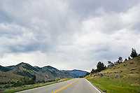 Highway 2 in Southwestern Montana with cloudy skies, USA.