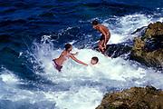 Kids splashing about in the sea, Cuba
