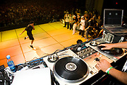 Dancer performing on stage with DJ decks in the foreground. UK B-Boy championships 06. 08/10/2006