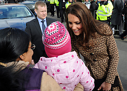 © Licensed to London News Pictures. 21/02/2012, Oxford, UK. Kate Middleton meets 4 year old GRACE SOY and members of the public who have waited in the freezing cold for over two hours outside the school. The Duchess of Cambridge Kate Middleton leaves Rose Hill Primary School in Oxford today 21 February 2012. Photo credit : Stephen Simpson/LNP