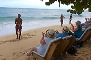 """Jamaican dancers solicit applause from cruise ship passengers at the """"Bamboo Beach Club""""."""