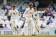 Wicket! Gareth Batty of Surrey bowled out lbw by Matt Milnes of Kent who celebrate with his team during the Specsavers County Champ Div 1 match between Surrey County Cricket Club and Kent County Cricket Club at the Kia Oval, Kennington, United Kingdom on 10 July 2019.