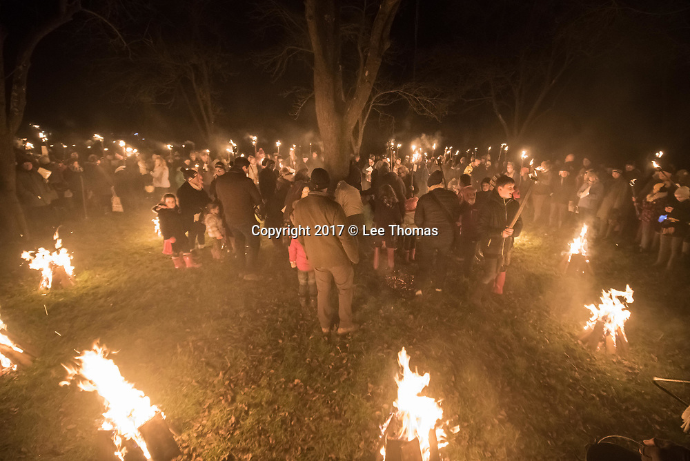 Much Marcle, Herefordshire, UK. 6th January 2018. Pictured:  Young and old gather around the apple tree.  / Hundreds of people both young and old gathered at the Westons Cider Mill and adjoining orchard to take part in the traditional Wassail ceremony. The event at Much Marcle in Herefordshire was attended by the Silurian morris side who entertained the crowd with witty repartee, raucous dancing and music. According to their website, the true origins of blackened faces are lost to history, but are widely believed to be simply a form of disguise, possibly to overcome the oppressive anti-begging laws of the 17th century, and the eternal embarrassment of being a morris man. The orchard-visiting wassail refers to the ancient custom of visiting orchards in cider-producing regions of England, reciting incantations and singing to the trees to promote a good harvest for the coming year  // Lee Thomas, Tel. 07784142973. Email: leepthomas@gmail.com  www.leept.co.uk (0000635435)