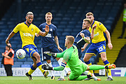 Southend United Goalkeeper Mark Oxley (1) manages to push away the ball from Leeds United Midfielder Kemar Roofe (7) during the Pre-Season Friendly match between Southend United and Leeds United at Roots Hall, Southend, England on 22 July 2018. Picture by Stephen Wright.