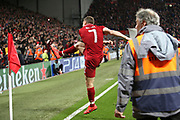 Liverpool midfielder James Milner (7) kicks the ball into the Kop as Liverpool beat Barcelona 4-0 during the Champions League semi-final, leg 2 of 2 match between Liverpool and Barcelona at Anfield, Liverpool, England on 7 May 2019.