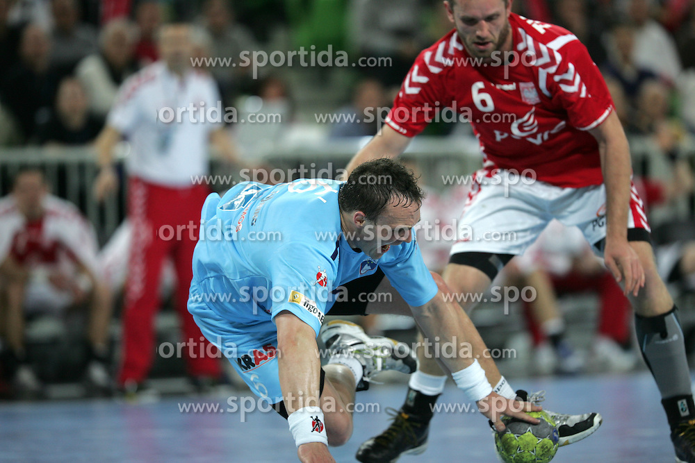 Uros Zorman (SLO) and Tkaczyk Grzegorz (POL) at handball match between National teams of Slovenia and Poland of Qualifications for EURO 2012, on March 9, 2011 in Arena Stozice, Ljubljana, Slovenia. (Photo By Vid Ponikvar / Sportida.com)