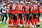 The Tampa Bay players huddle round Tampa Bay Buccaneers Quarterback Jameis Winston (3) during the International Series match between Tampa Bay Buccaneers and Carolina Panthers at Tottenham Hotspur Stadium, London, United Kingdom on 13 October 2019.