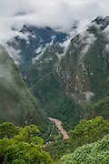 Andes Mountains cloudforest and Vilcanota River from Machu Picchu, Peru. The Vilcanota is also known as the Urubamba River.