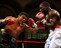 August 31, 2007; Atlantic City, NJ, USA; Juan Urango (black trunks) and Nasser Athumani (white trunks) trade punches during their 10 round bout at Boardwalk Hall in Atlantic City, NJ.  Urango won the bout via 4th round TKO.