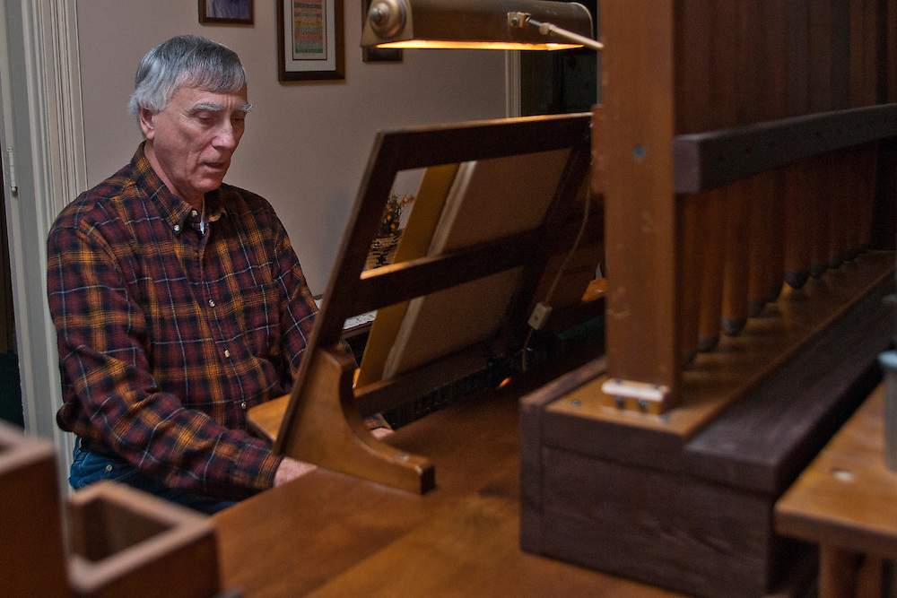 Lathan Goumas | The Bay City Times..Don Sandor plays the pipe organ which sits in the living room of his home in Bay City, MI., on Thursday September 29, 2011. Sandor put the electro pneumatic organ together himself 22 years ago.