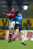 Perugia 26/2/2004 Uefa Cup Third round 1st leg <br />Perugia Psv Ehindoven 0-0 <br />An air challenge between Giovanni Ignoffo (Perugia) and Ji-Sung PARK (PSV)<br />Foto Andrea Staccioli Graffiti