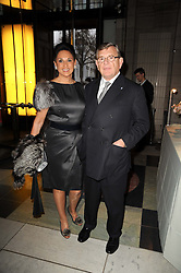 GERALD RONSON and his wife GAIL at the opening of the Victoria & Albert Museum's latest exhibition 'Grace Kelly: Style Icon' opened by His Serene Highness Prince Albert of Monaco at the V&A on 15th April 2010.