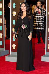 © Licensed to London News Pictures. 18/02/2018. SALMA HAYEK arrives on the red carpet for the EE British Academy Film Awards 2018, held at the Royal Albert Hall, London, UK. Photo credit: Ray Tang/LNP