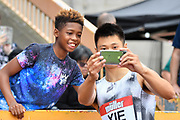 Wenjun Xie (CHN)  poses for a selfie with a young fan during the Birmingham Grand Prix, Sunday, Aug 18, 2019, in Birmingham, United Kingdom. (Steve Flynn/Image of Sport via AP)