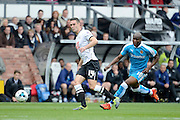 Derby County defender Jason Shackell plays the ball away from Wolverhampton Wanderers striker Benik Afobe during the Sky Bet Championship match between Derby County and Wolverhampton Wanderers at the iPro Stadium, Derby, England on 18 October 2015. Photo by Alan Franklin.