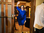 12 JANUARY 2020 - PERRY, IOWA: US Senator AMY KLOBUCHAR (D-MN) waves as she walk into a campaign event at the Hotel Pattee in Perry, IA, Sunday. Sen. Klobuchar brought her presidential campaign to Perry, a farming community about 50 miles west of Des Moines. Iowa hosts the first event of the presidential selection process in February. The Iowa Caucuses are Feb. 3, 2020.     PHOTO BY JACK KURTZ