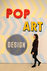 © Licensed to London News Pictures. 21/10/2013. London, UK. A woman at The Pop Art Design Exhibition preview at The Barbican Centre. Photo credit : David Mirzoeff/LNP