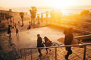 People descending to Gordon Beach, Tel Aviv at sunset