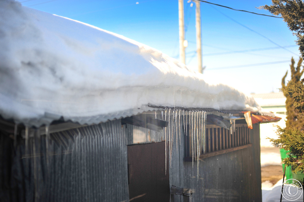 Japan in winter. Icicles hanging from the roof of this old shed.