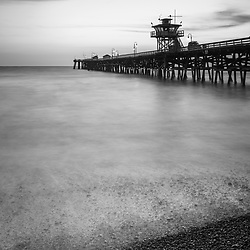 California San Clemente pier black and white picture. San Clemente is a popular coastal city in Orange County California in the United States of America. Copyright ⓒ 2017 Paul Velgos with all rights reserved.