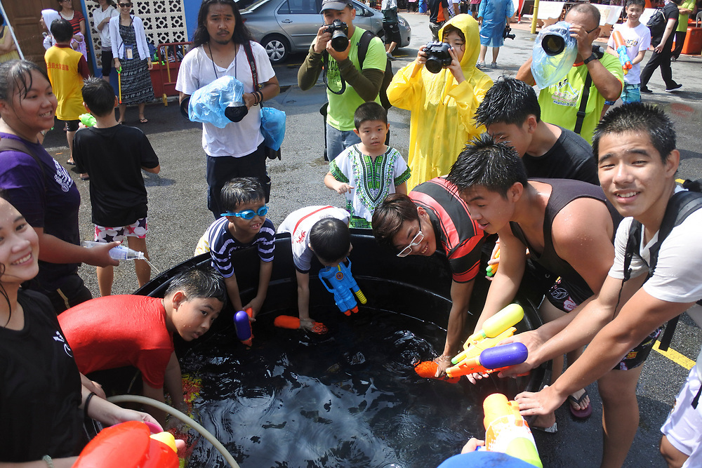 People filling up water pistols at the Songkran Festival in Penang